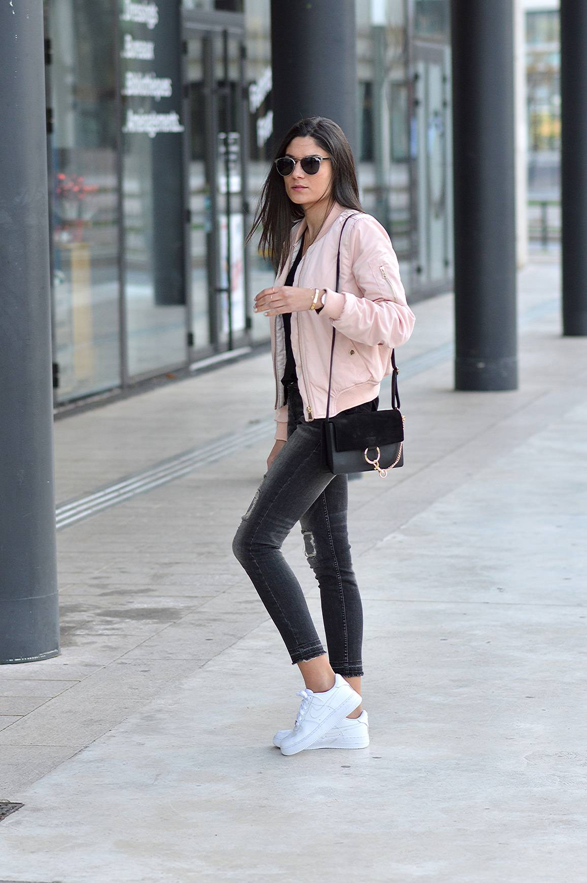 Federica L. wears the bomber jacket in a pretty shade of pale pink, capturing