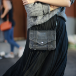 The pleated skirt trend is definitely not one to miss this season! Wear the look in simple black maxi style to achieve something like Forever Vanny's minimalistic elegance. Sweater: Zara, Skirt: Aritzia, Shoes: Schutz, Bag: Proenza Schouler.