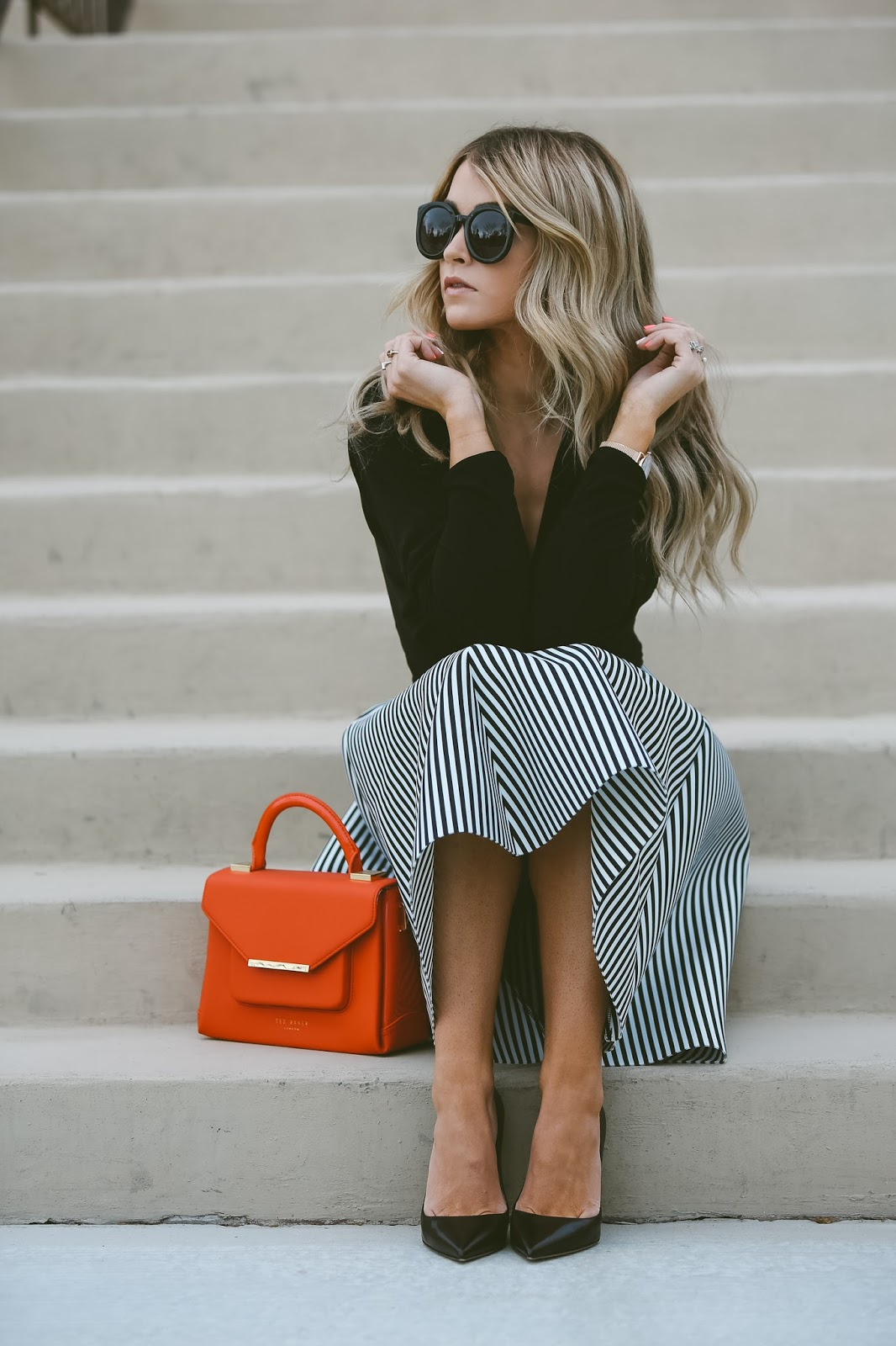 Statement patterns are in this spring! Cara Loren is wearing a gorgeous striped A line skirt, creating an ultra sophisticated look paired with a simple black top. The key with statement prints is to keep the other details of your outfit to a minimum, so as not to detract attention! Skirt: Windsor, Top: Shopbop, Shoes: The Cammeo.