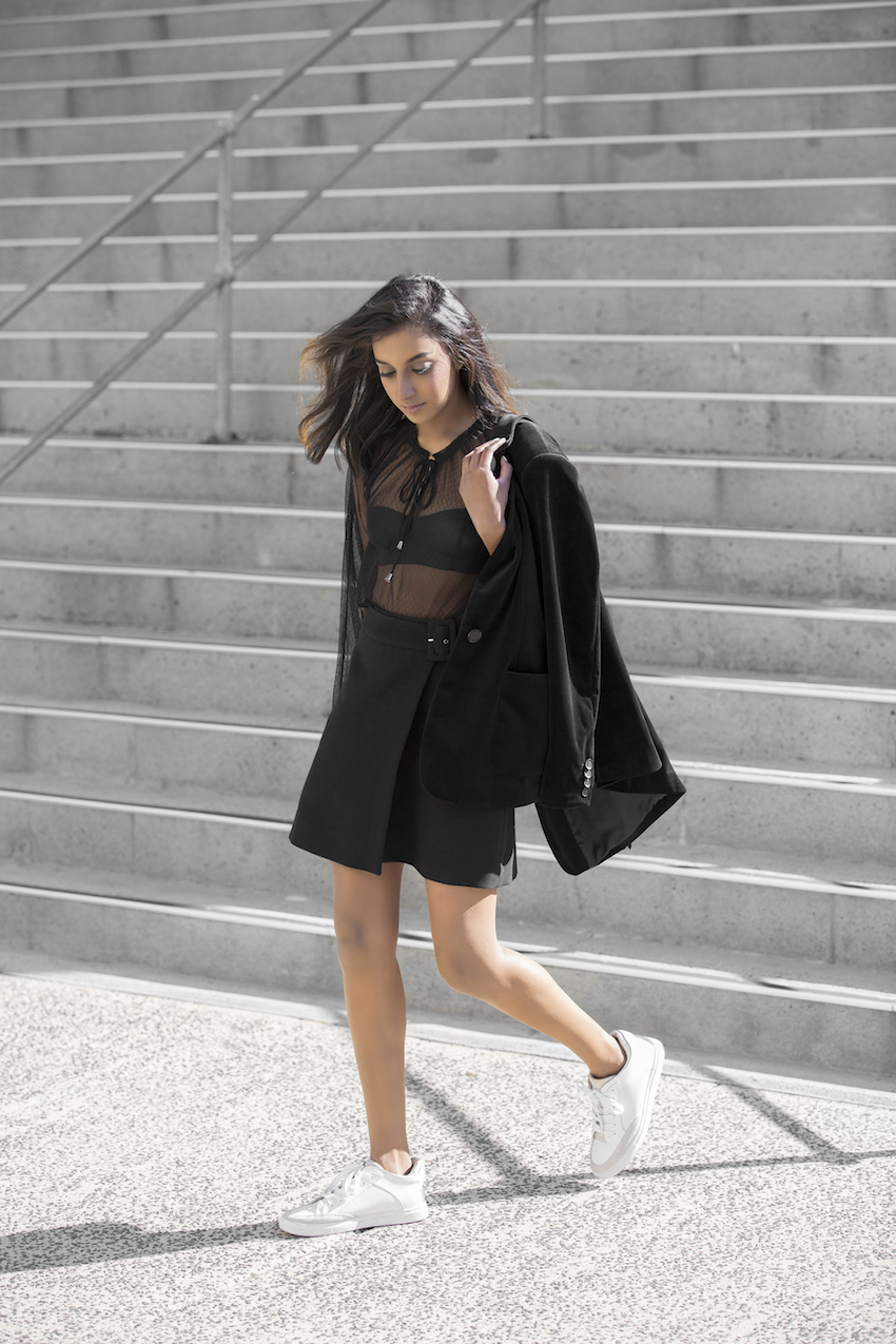 Wear the sheer black trend with a black bralette and a wrap around skirt to steal Vydia Rishie's edgy and alternative style. We love the mysterious aesthetic of this look! Outfit: Witchery.