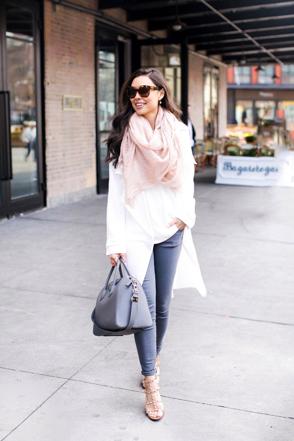 Kat Tanita has styled a beautiful white coat with a blush pink scarf to add another dimension of femininity to her look. Worn with jeans and a Givenchy bag, this outfit is perfect for hitting the town! Jacket: Adrianna Papell, Jeans: Elliott, Sandals: Valentino, Scarf: Nordstrom, Bag: Givenchy.