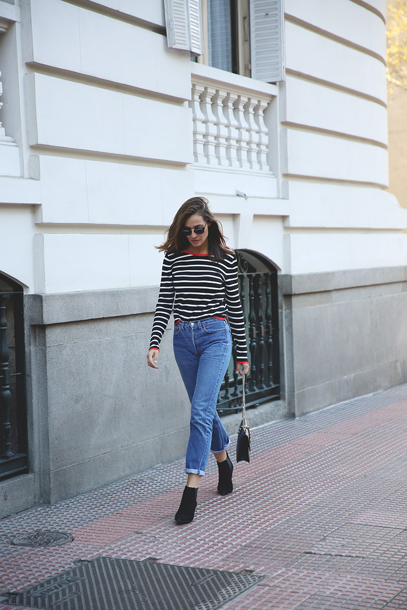 Steal Silvia Zamora's retro Parisian look by wearing a classic navy and white nautical style top with high waisted jeans and a pair of black Chelsea boots! A pair of vintage shades will also give this look that spring feel you crave! Sweater: Zara, Jacket: Maje, Jeans: Levi's, Shoes: Senso.