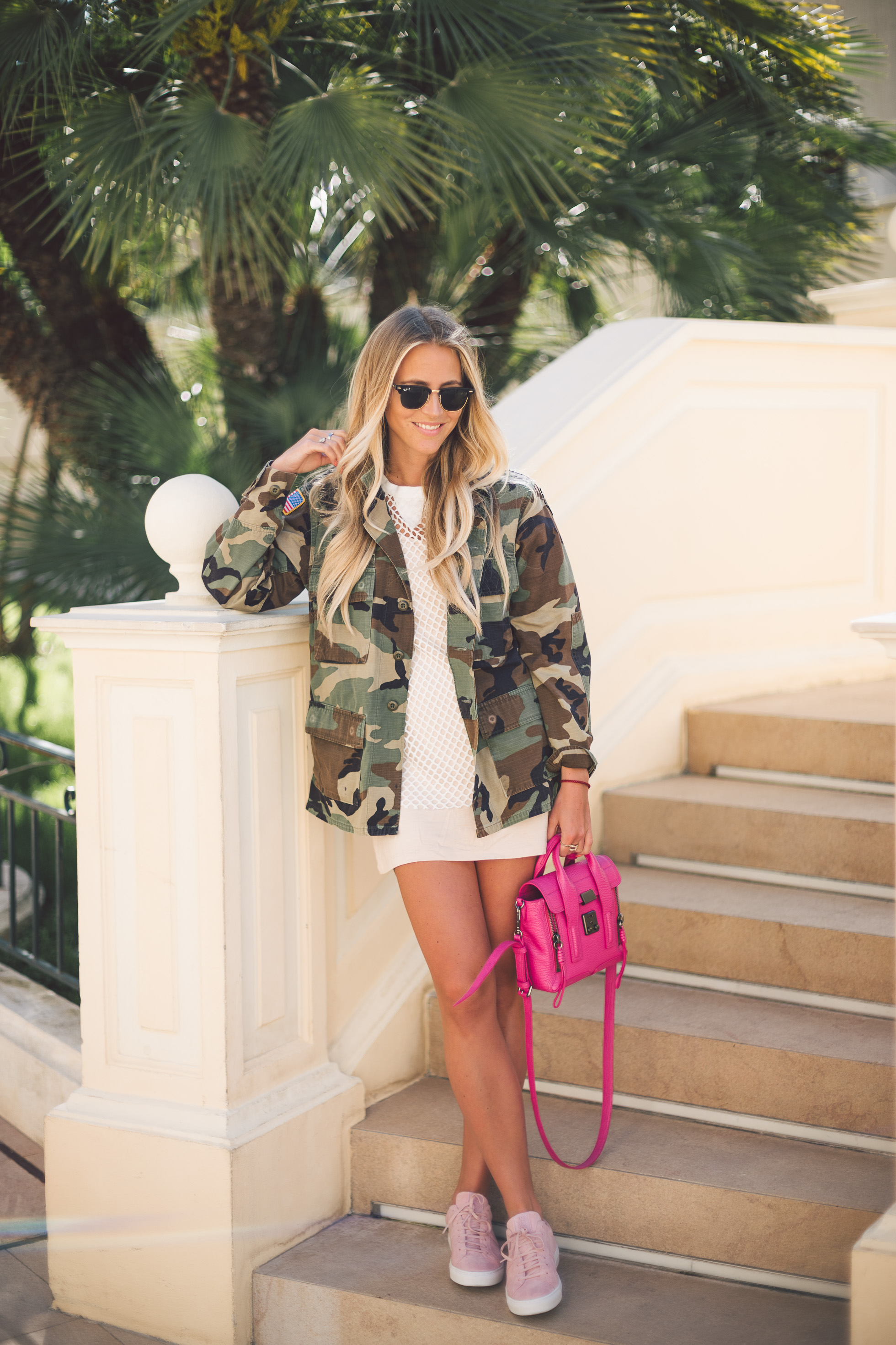 For a classic and timeless style, try wearing an army style camo jacket over a mini dress or a simple top. Janni Deler shows us how it is possible to bring a feminine twist to the look by choosing a hot pink bag and matching sneakers! Jacket: JN Llovet, Dress: Choies, Bag: Phillip Lim, Shoes: Jim Rickey.