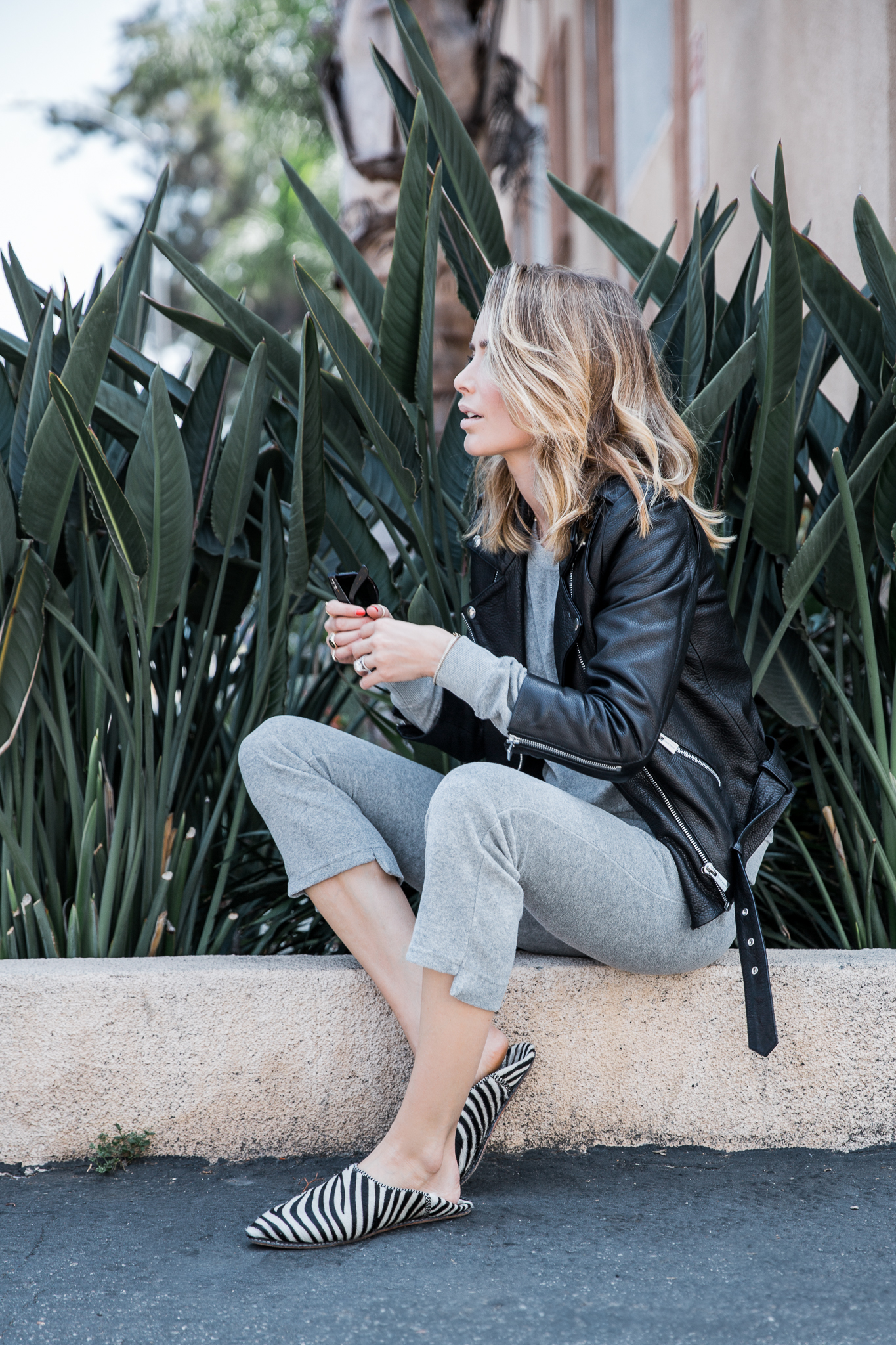 Leather jackets are perhaps the most adaptable piece of any girl's wardrobe. Anine Bing shows us how to rock leather over lounge-wear in this chic two piece from Ragdoll, paired with a cropped jacket with metallic zip detailing. Jacket: Anine Bing, Tracksuit/Shoes: Ragdoll.