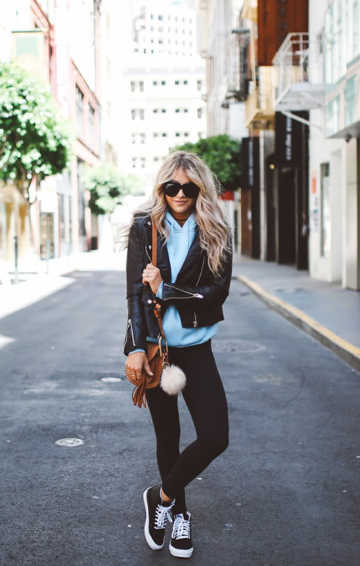 Cara Loren keeps it casual in a simplistic stripped back style consisting of a baby blue hoodie, black leggings, sneakers, and a sleek leather jacket. This style is just ideal for everyday wear! Hoodie: Nordstrom, Leggings: Lulu Lemon.