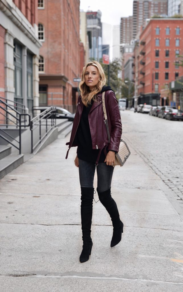 Lisa D Cahue demonstrates yet another way to style the leather jacket trend; with a simple hoodie! By throwing a leather jacket over a hoodie, you will add endless glamour and really dress up the simplest of styles. Sweater: LPA, Jacket: IRO, Jeans: Zara, Boots: Stuart Weitzman, Bag: Chanel.