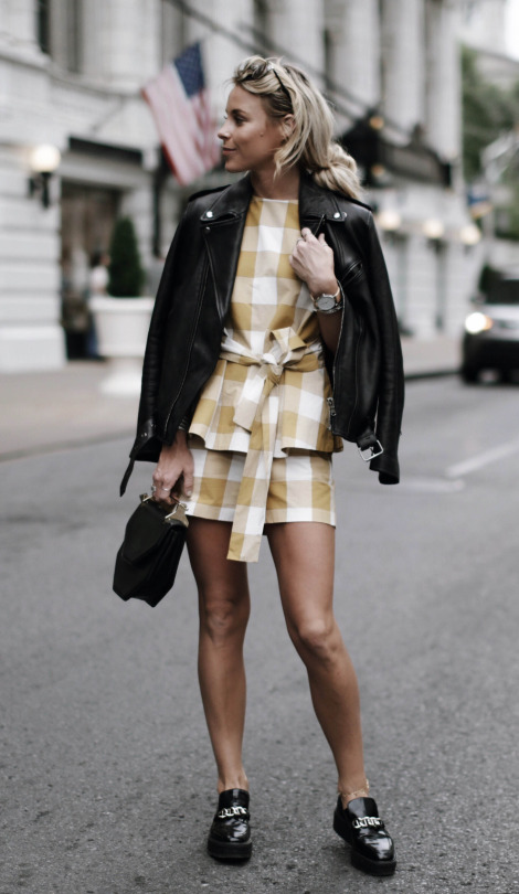 Mary Seng punks up this cute summer outfit by throwing on a boyfriend fit leather jacket to match her edgy leather loafers. This gingham print two piece is cute and feminine, and provides a great contrast to this awesome leather jacket. Top/Shorts: Ann Taylor, Jacket: AG.