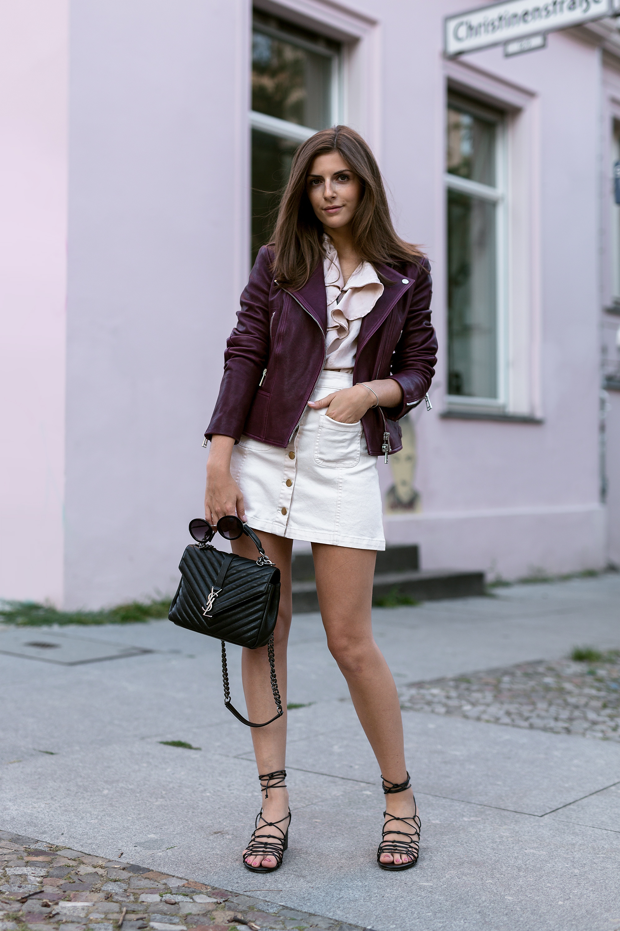 Go against tradition, and make summer leather your style! Valerie Husemann is killing it in this gorgeous plum piece, paired thoughtfully with a button front skirt and gladiator sandals. Jacket: Belstaff, Blouse: Zara, Skirt: Stradivarius, Bag: Saint Laurent, Shoes: Mango.