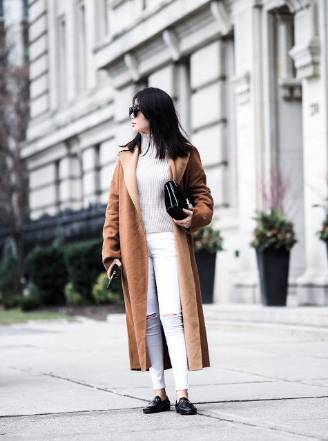 Cher Bai is ultra stylish in this loafer look, consisting of a beige turtleneck top, white distressed jeans, and a gorgeous oversized camel coat. These black loafers enhance the contrast of black and white beautifully, and add to the overall aesthetic!  Brands not specified.