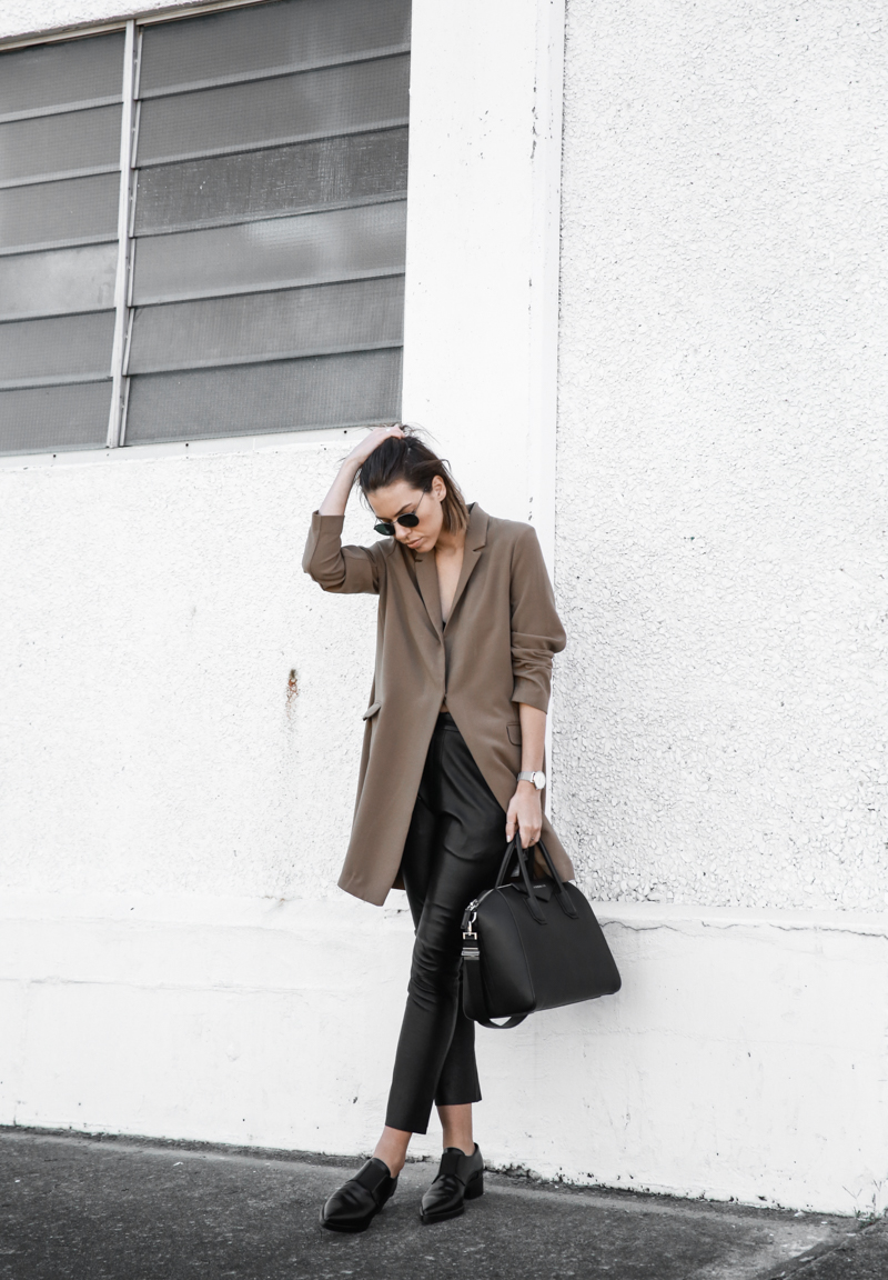 Loafers will look effortlessly class styled with a pair of leather trousers and an oversized blazer, as demonstrated through this retro outfit worn by Kaitlyn Ham. We love the timelessness of this look! Trousers: Bassike, Blazer: Asos, Loafers: Stella McCartney, Bag: Givenchy.