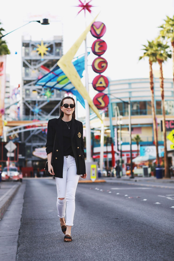 Andy Torres pairs her classic white jeans with an oversized vintage Ralph Lauren blazer; the perfect choice for a striking retro style! Throw in a pair of loafers and some wide rim sunnies to steal Andy's look! Jeans: DL1961, Shoes: Senso, Blazer: Vintage Ralph Lauren, Bag: Neri Karra, T-Shirt: ASOS.