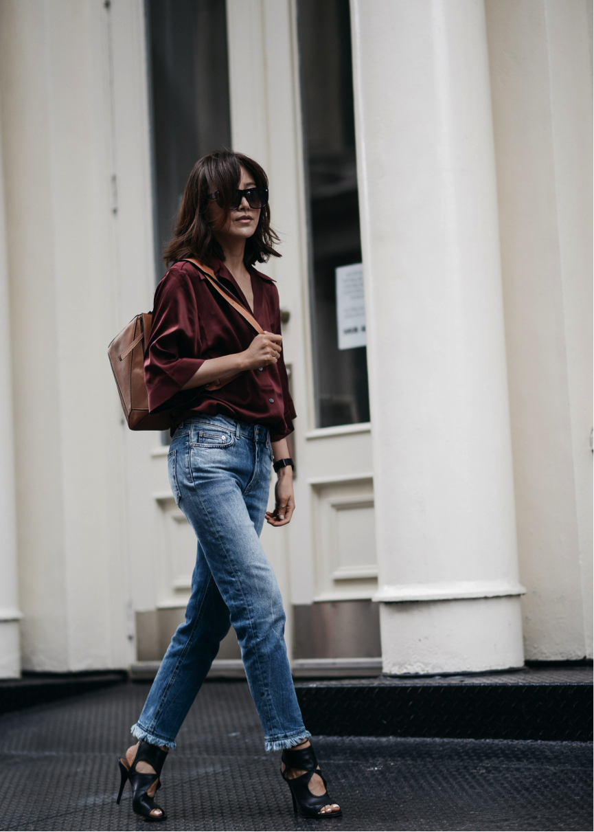 Want an alternative to a classic look? Diana Z. Wang rocks straight-cut jeans with awesome frayed edges, a chic burgundy blouse and some statement heels. A must have look this season. Distressed Mid-Rise Slim Boyfriend Jeans/Silk Blouse - Acne Studios Back Keyhole Sandal- Aquazzura