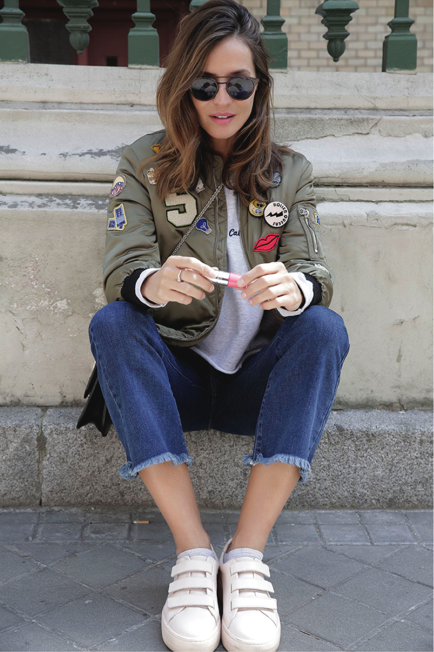 Silvia Garcia adds a playful dimension to her look through using patches. The patches exude a sense of vibrancy, making for a contemporary look. Jacket/Jeans: Zara, Shoes: Sandro