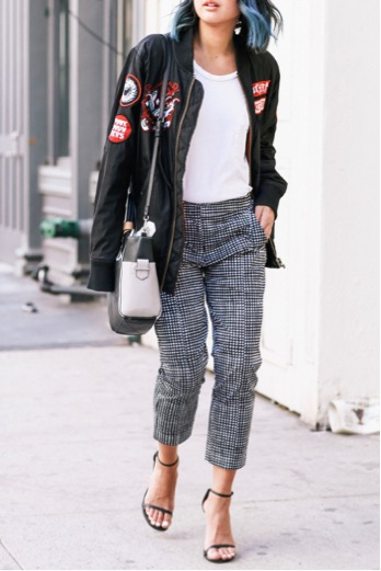 Serena Goh looks incredible in this monochrome look. The patches on the black bomber add a unique pop of colour, creating an edgy, yet chic element to the piece. Jacket: Cukui, Trousers/Bag: Reed Krakoff