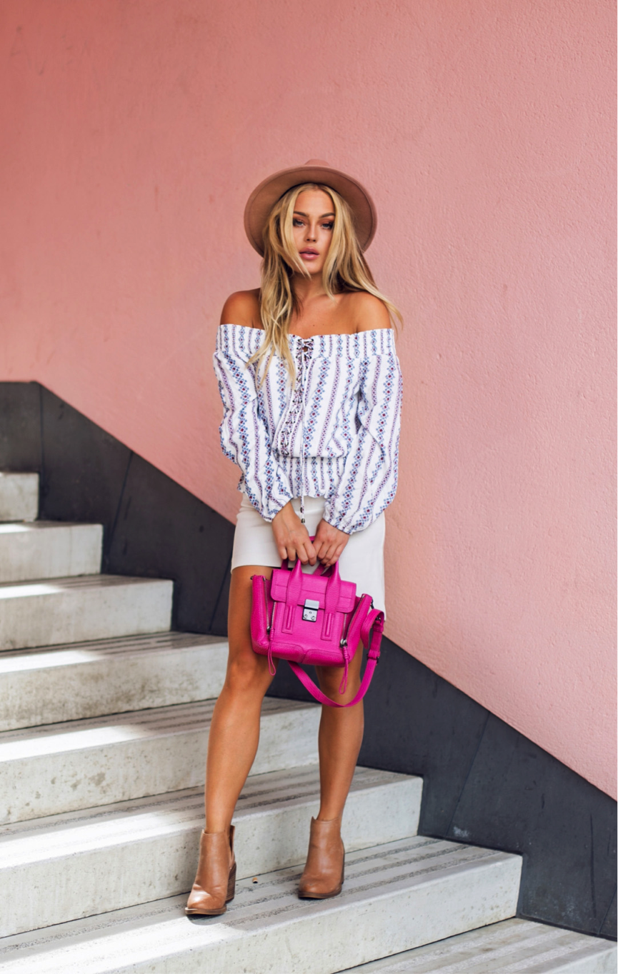 Pretty in pink, Angelica Blick adds a pop of colour to this cute feminine number. An off-the-shoulder top, paired with a simple skirt is a staple look this season. The pink bag adds a different dimension to this outfit, making the look super vibrant. Top/Shoes: ASOS, Skirt: H&M, Bag: Philip Lim