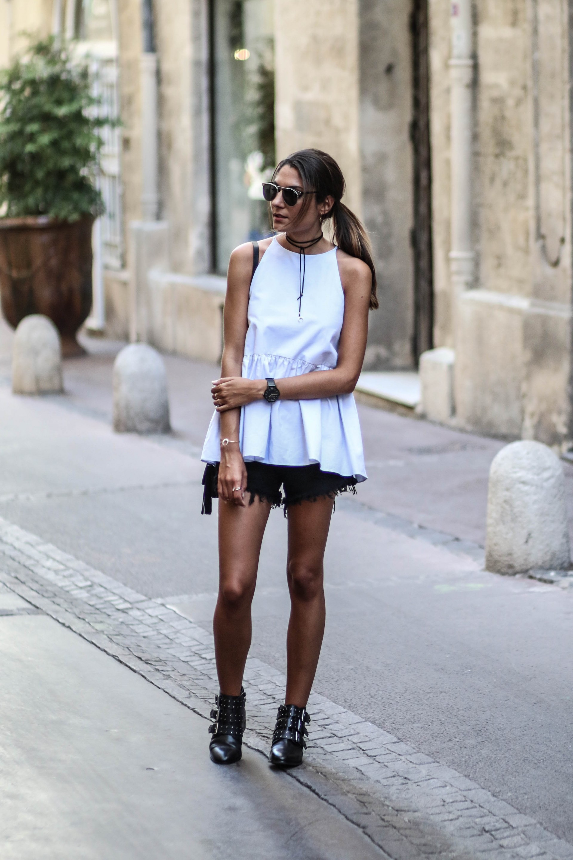 Generate a more punk rock vibe by pairing contrasting colours, and applying more studded materials to your look. Federica L. is rocking this awesome blend of the feminine and the boyish, combining studded ankle boots with a floaty baby blue vest. Top: Zara, Shorts: Shein, Shoes: Asos.