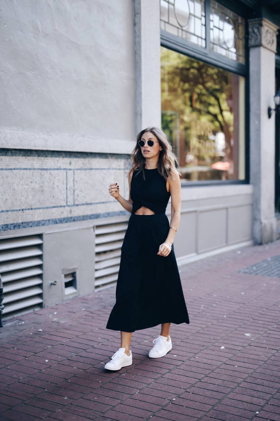 Pairing sneakers with a dress or two piece is a simple but effective way to create an urban street chic style which is ideal for everyday wear. Throw on a pair of retro shades to steal Jill Lansky's summer look. Dress: T by Alexander Wang, Sneakers: Adidas Stan Smith.
