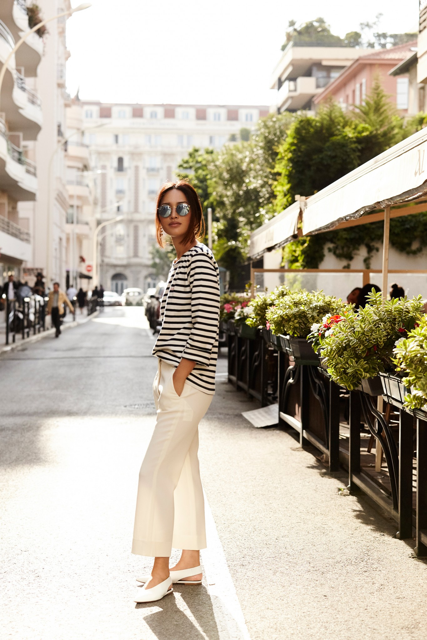 Nicole Warne has created a gorgeous summer outfit here.COnsisting of a sailor style striped tee, crisp white culottes, and a pair of white sandals which perfectly contrast a summer tan, this look is ready to go! Tee: Chopard, Trousers: Stella McCartney, Shoes: Celine.