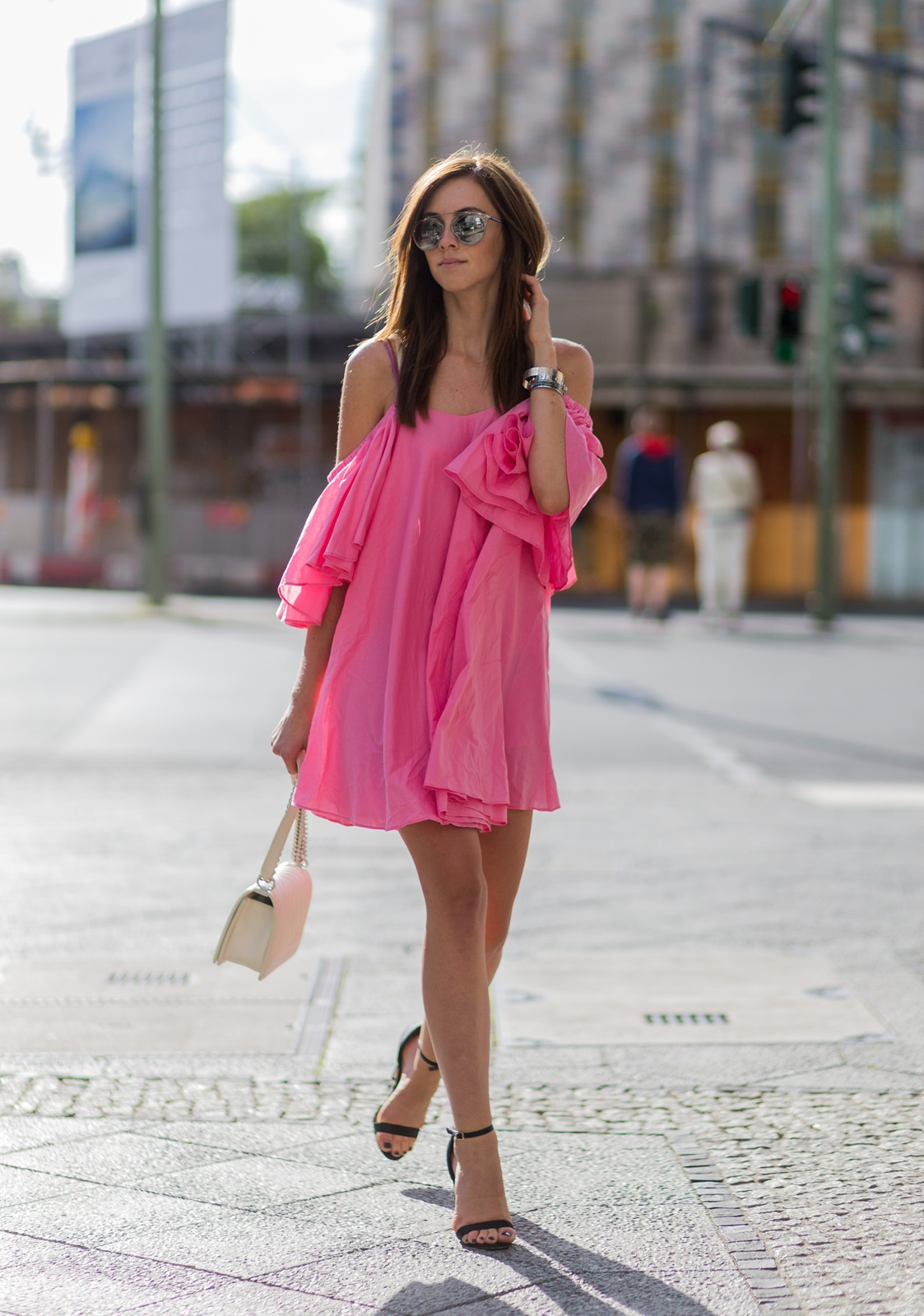 Dare to wear pink this summer! Barbora Ondrackova is absolutely dazzling in this gorgeous ruffle dress, which she has simplistically paired with black stilettos to create an uber feminine and sexy style. Dress: Storets, Heels: ASOS, Bag: Chanel.