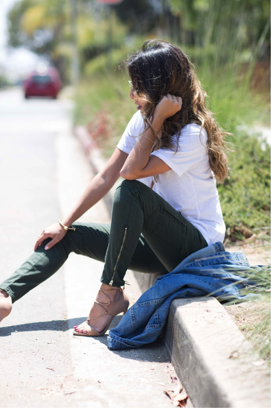 Cargo pants are resurfacing as an essential item in your wardrobe this season. Perfect for a chilled day, and easily wearable on any occasion, they are a must have. Ashley Torres styles them with nude heels, a simple white top, and cool denim jacket. Trousers: J Brand, Heels: Nordstrom, Jacket: Revolve