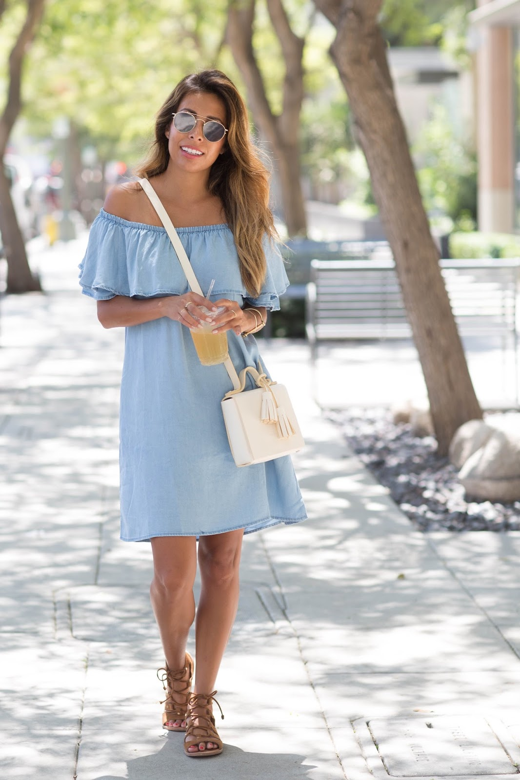 Dare to show some skin in an off the shoulder dress this summer, and achieve a gorgeous carefree style like Ashley Torres! Pair a denim dress such as this with gladiator sandals and rock this look. Dress: Chicwish, Sandals: Dolce, Bag: Less Bore.