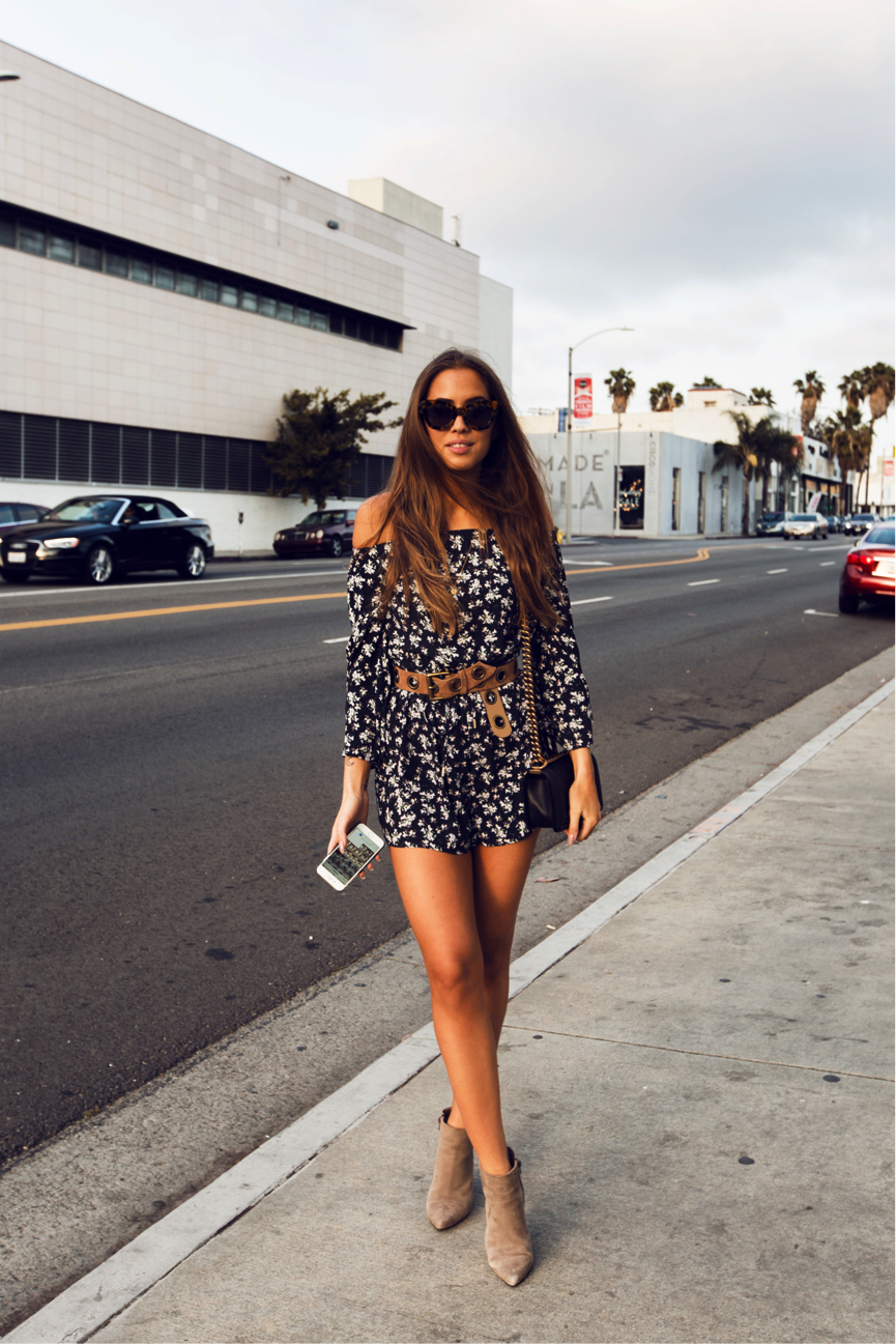Kenza Zouiten models a sophisticated twist on the bohemian style in this floral playsuit, paired with some heeled pixie boots. Such an uncomplicated, yet effective, outfit, we think this is ultra-summery. Playsuit: Ivyrevel, Boots: Brand not specified