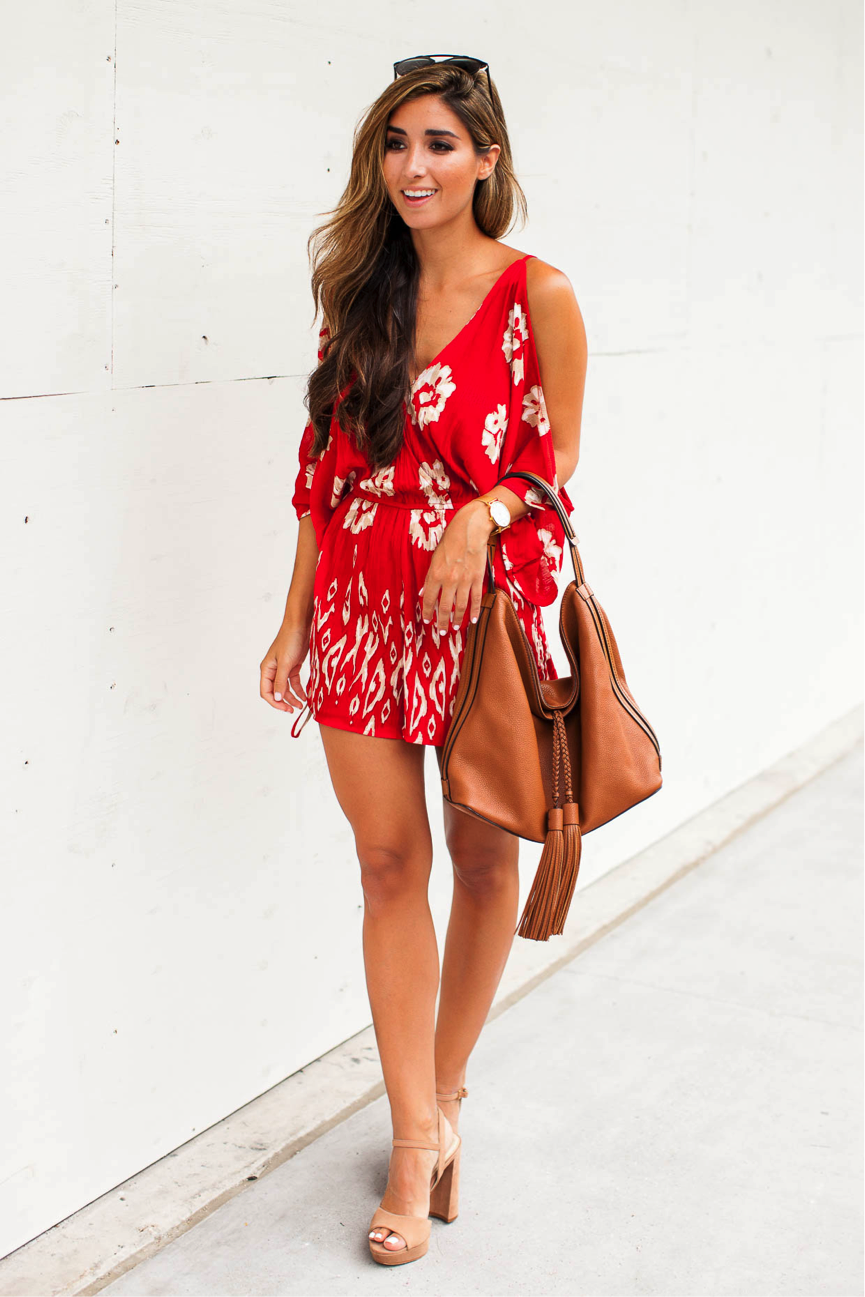 Jessi models the perfect beach outfit in this vibrant romper. Style with nude heels and a handbag for an outfit suitable for a dressier occasion. This is the ultimate summer outfit. Romper/Heels: Nordstrom