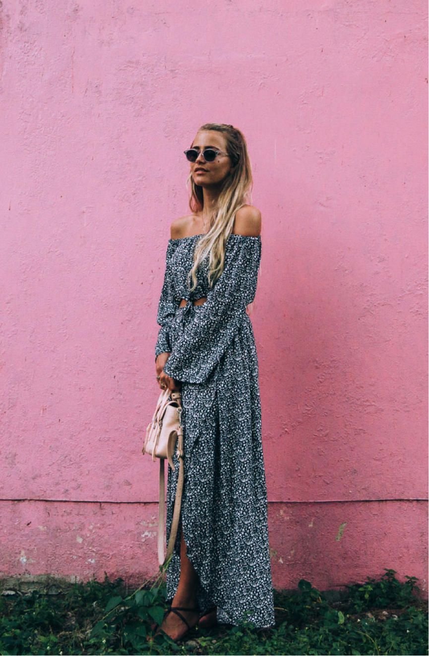 Janni Deler has opted for a boho look in this long co-ord. The off-the-shoulder top is highly flattering, and we love the overall pattern of the two-piece. This would be great on a summer day. (The pink wall makes a cool backdrop too!) Top/Skirt: Faitfull The Brand, Glasses: Chimi Eyewear