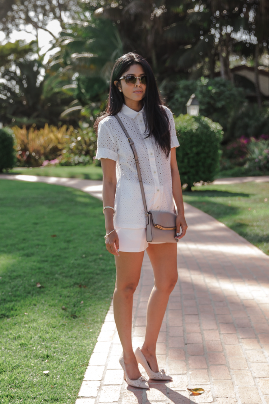 Sheryl Luke models a more tailored summer look in this buttoned up white shirt, and white shorts. We love that she has paired them with some adorable nude heels, and a similar nude bag. Shirt/Shorts/Heels: Kate Spade New York