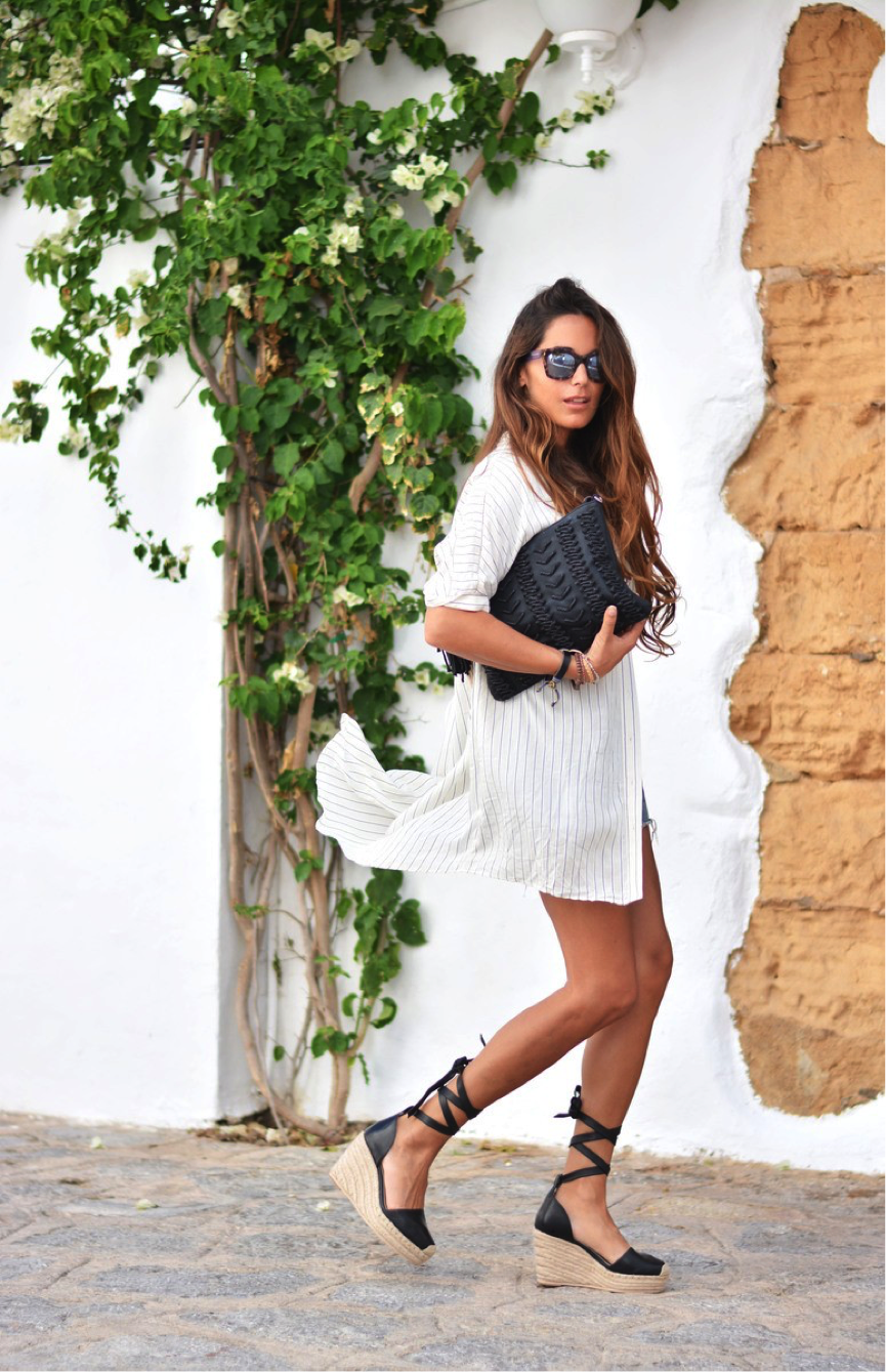 Maria Tilve radiates summery vibes in this striped shirt. She has opted to wear it over shorts, but alternatively it could be worn with swimwear for the perfect beach look! Shirt: Zara, Shorts: Levi's, Espadrilles: Revolve