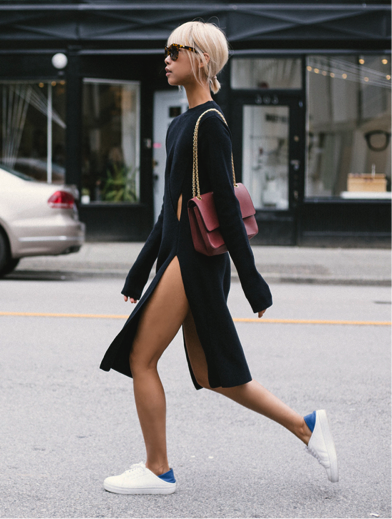 Vanessa Hong rocks a somewhat daring piece, in this criss cross slit dress. Pair it with some sneakers and a simple handbag for a more casual look; the long sleeves make it the ultimate look for those seasonal days which aren't so sunny! Dress: THPLab, Sneakers: Senso