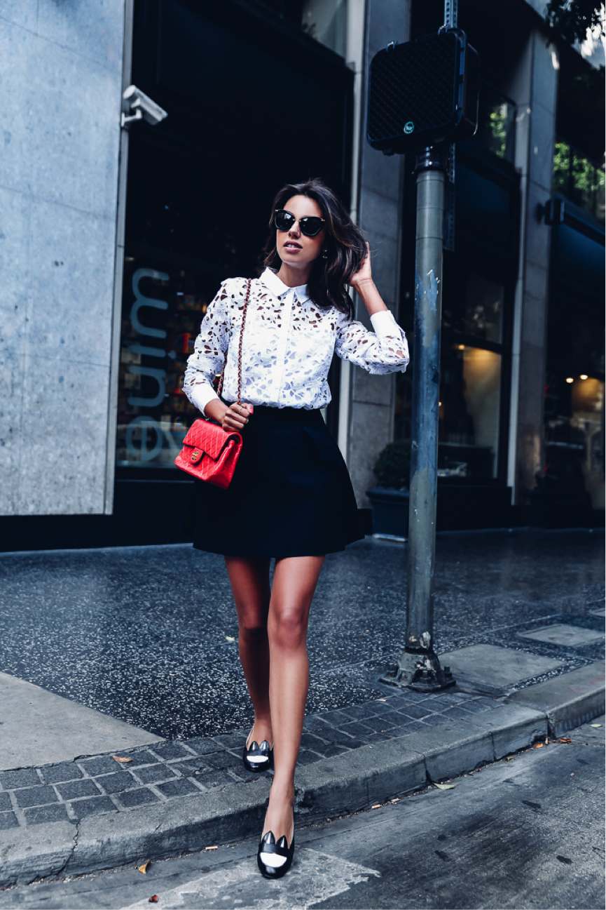 Annabelle Fleur is the epitome of summer chic in this cute feminine look. The dress and shirt are great for a fancy occasion, and we love the pop of colour with the handbag. Shirt: Banana Republic, Skirt: Ellery, Bag: Chanel
