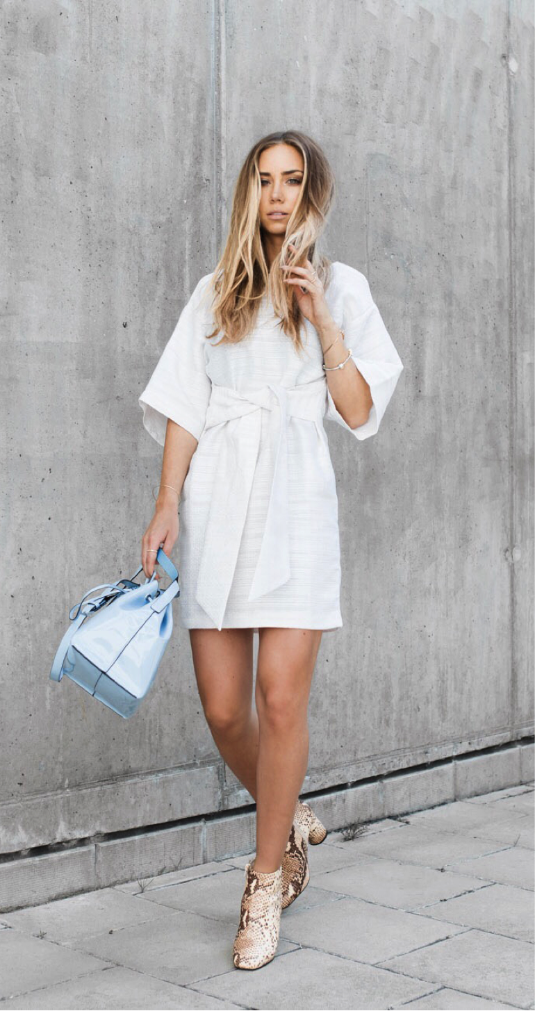 Lisa Olsson looks very glamorous in this summery white dress. We are obsessed with the tie front detailing, which gives the look a different edge (which is further accentuated by the bold animal print shoes!) Dress: ASOS, Shoes: Jennie-Ellen