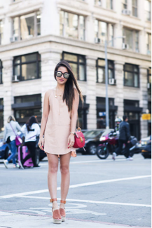 Wendy Nguyen looks really cute in this summer dress. The light pink colour is really flattering, and we love its pairing with the beige sandals. Dress: Mason, Shoes: Chloe
