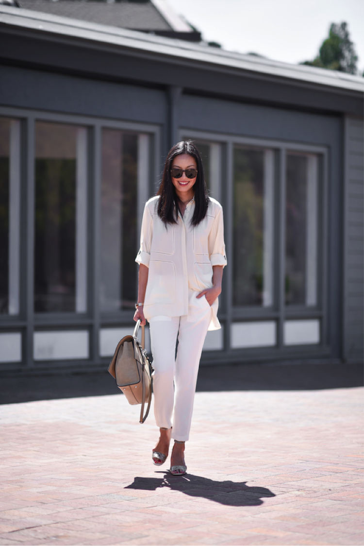 Sometimes the simplest looks are the most effective. Ann Taylor certainly demonstrates this in her white summer outfit. Styled with some statement sunglasses and handbag, a bold look is made. Blouse/Trousers: Nordstrom, Shoes: Manolo Blahnik