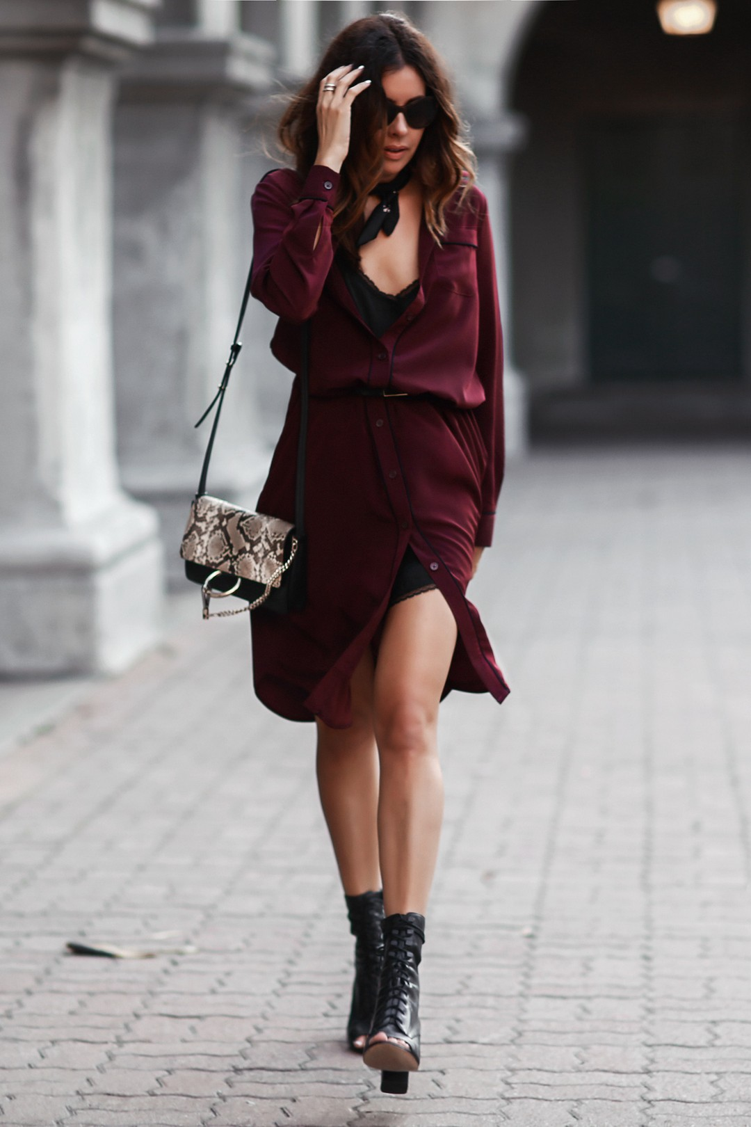 If you're looking for a smart and sophisticated summer style, give the shirt dress trend a go. Erica Hoida demonstrates how to wear a shirt dress, pairing this plum number with a neckerchief and laced summer boots to create an edgy yet elegant style. Dress/Neckerchief: Who What Wear Collection, Shoes: Elizabeth & James, Bag: Chloe.