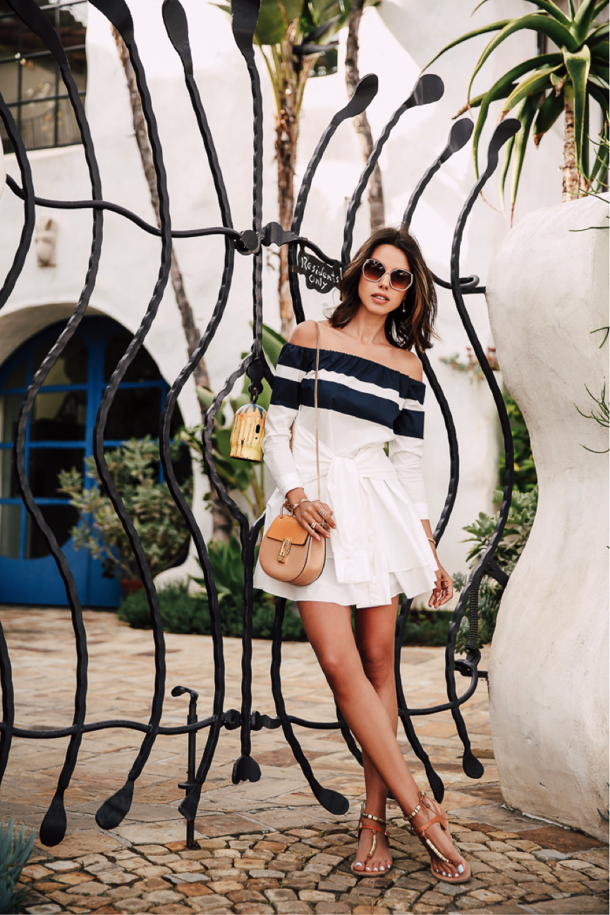 Make your mark in monochrome this season. Annabelle Fleur opts for this monochrome dress; the off-the-shoulder makes it right on-trend, and gives the look a cute feminine touch. Dress: Intermix, Sandals: Net a Porter