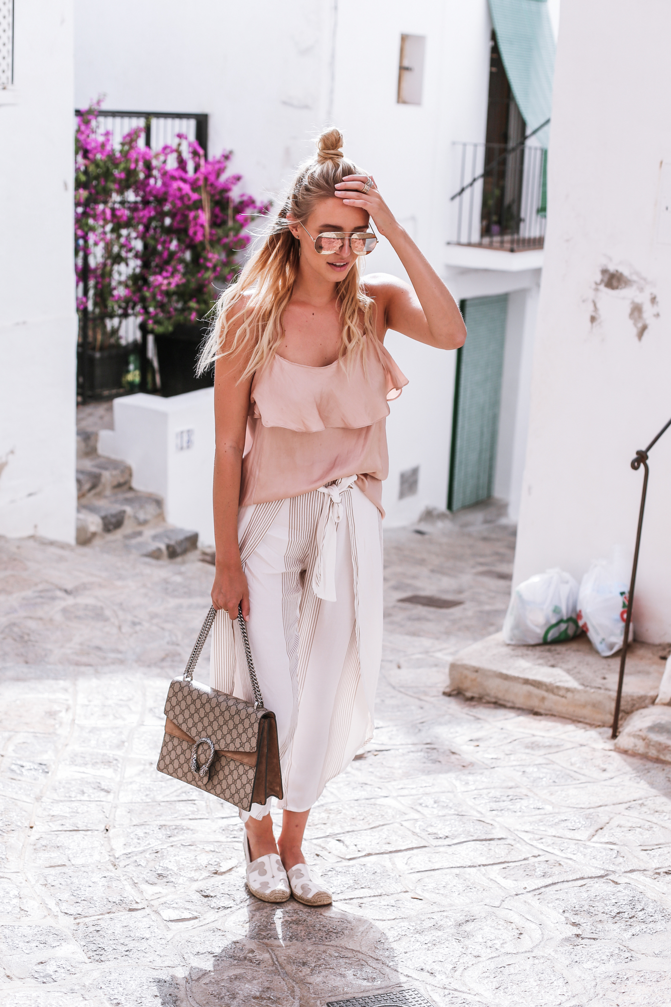 Loose trousers should be in everyone's summer wardrobe; they are perfect to travel in, and, not only do they look good, but they are super comfy! We love these striped ones modelled by Leonie Sophie. She chooses to pair hers with a pastel pink top. Trousers: Shopbop, Top: Zara