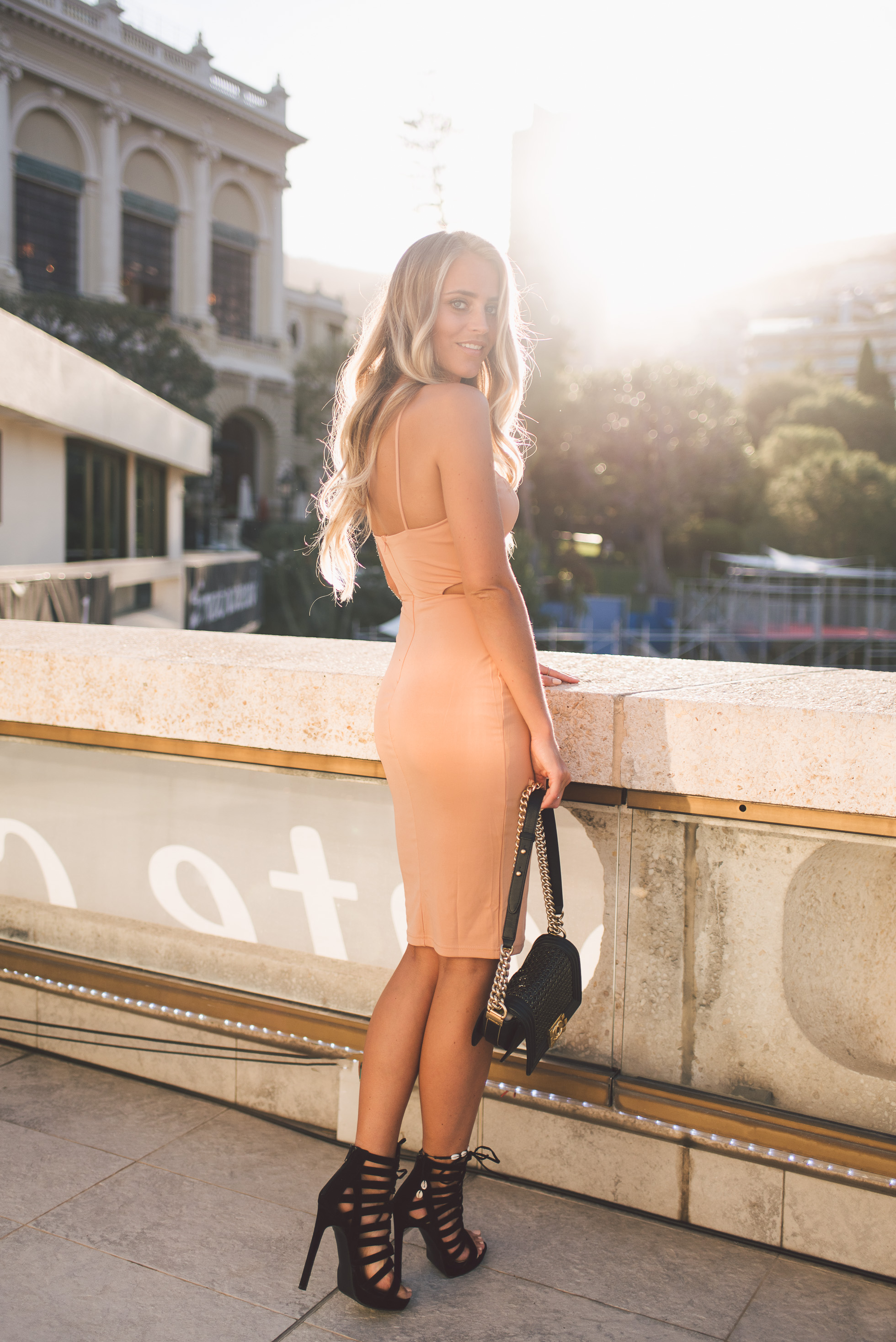 The perfect way to show off your summer body is to wear a bodycon dress like Janni Deler. The pastel pink colour is really complimentary, and paired with high heels and a simple bag creates the ultimate outfit for a more sophisticated occasion. Dress: Chiquelle, Bag: Chanel, Shoes: Public Desire