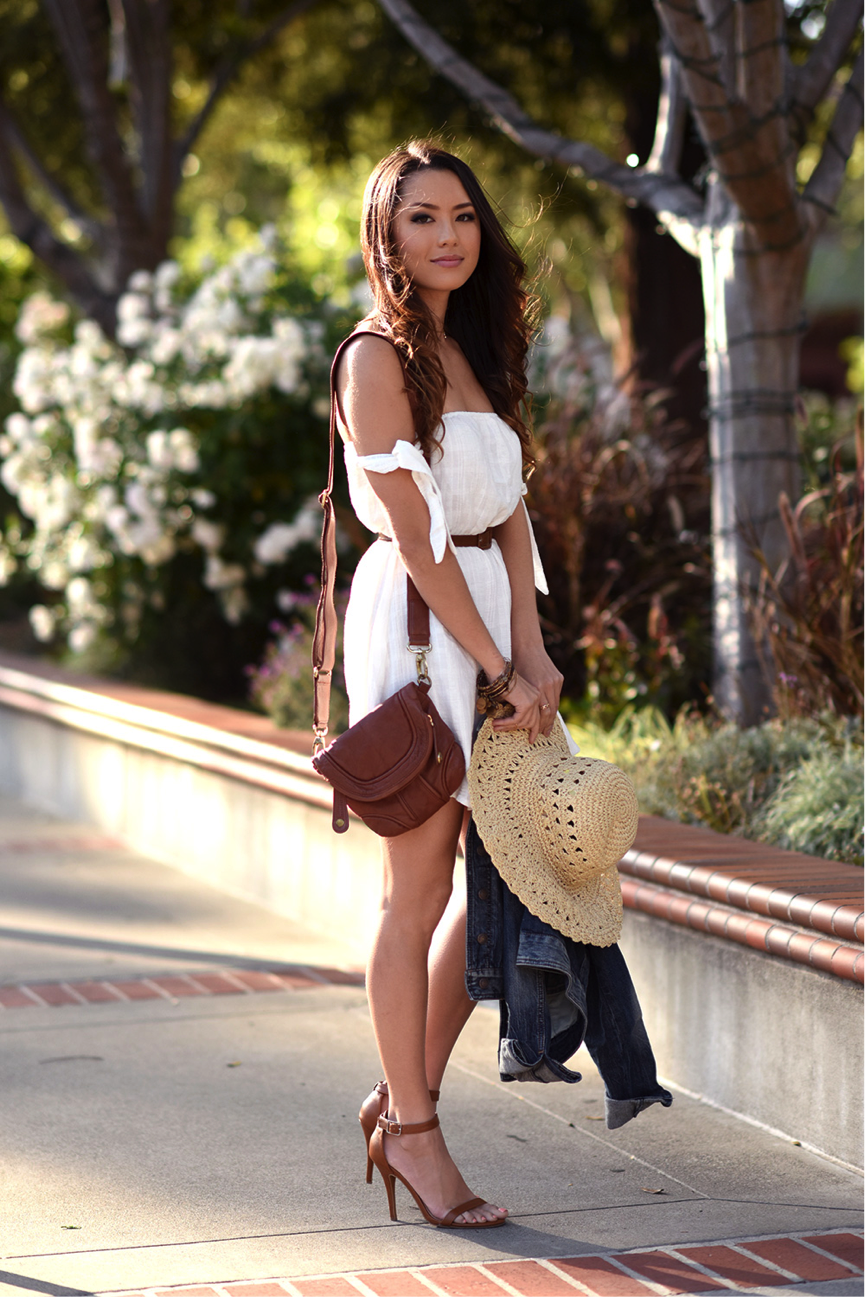 Jessica R. opts for a sophisticated bohemian summer look in this simple white dress. We are obsessed with the detailing on the sleeves, giving the appearance of an off-the-shoulder aesthetic. Pair with some cute heels for a glamorous look, or alternatively dress down with a denim jacket. Dress: Lulus, Jacket: Express, Heels: Charlotte Russe