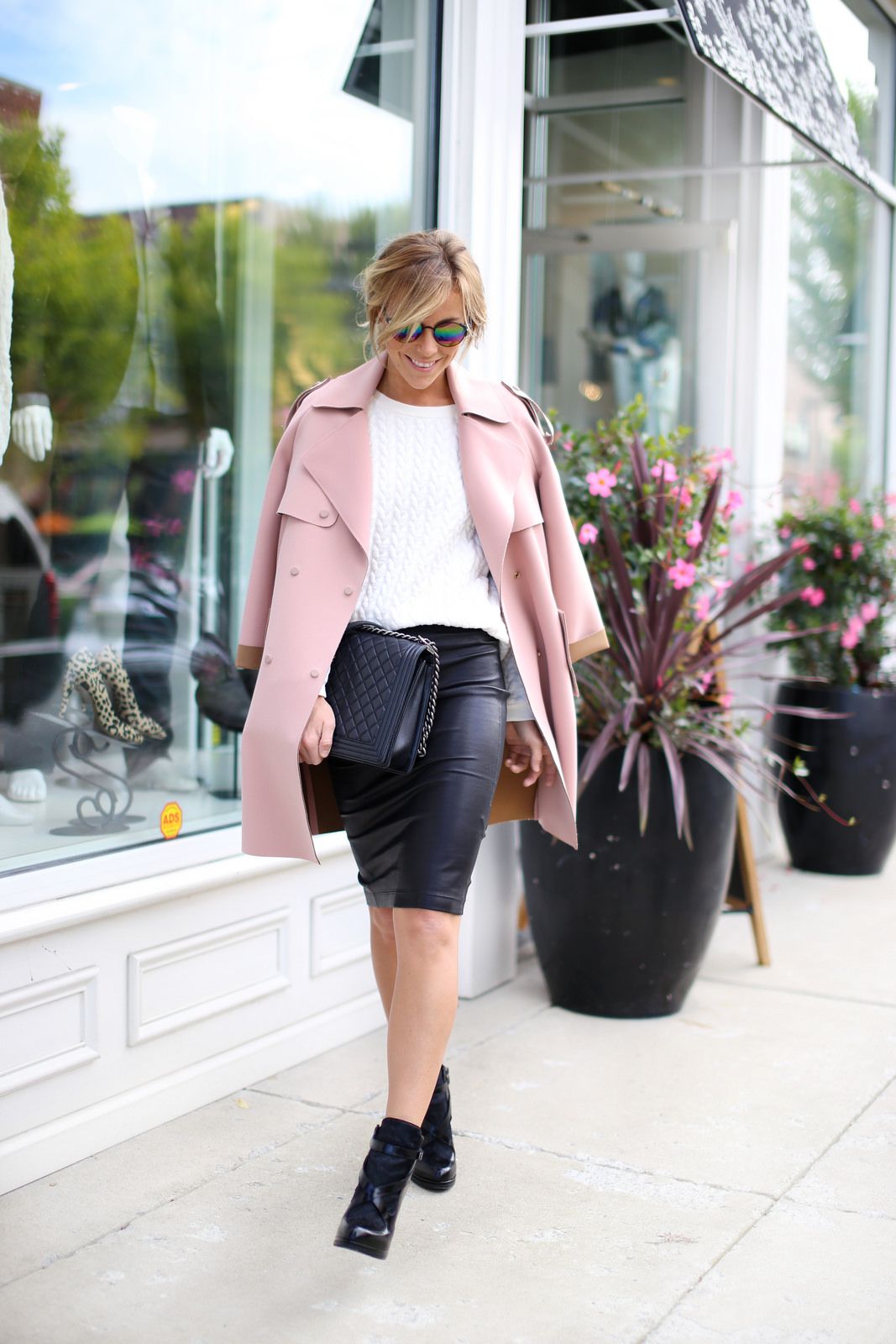 Mary Seng, too has the feminie rockstar routine down with a pretty pink pea coat, cableknit sweater and high-heeled booties. We love the combination of fabric and textures from the patent leather heels to the quilting on her purse. Don't be afraid to mix and match metallic and soft materials to create your own signature look. Skirt: Helmut Lang, Top: Vince Camuto, Coat: Topshop, Shoes: French Connection, Purse: Chanel, Sunglasses: Nordstrom