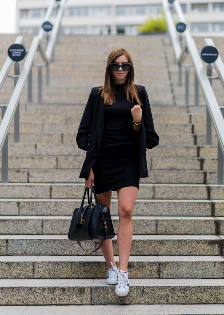 Barbora Ondrackova proves you can look casual and sophisticated whilst being off duty. She teams her Adidas sneakers with a body con dress for an elegant yet comfortable outfit. Wear this look in the evening with this season's velvet stiletto to add a unique twist. Dress: Nakd, Blazer: Zara, Sneakers: Adidas, Bag, Saint Laurent, Sunglasses: Chanel, Watch: Marc Jacobs, Bracelet: Hermes