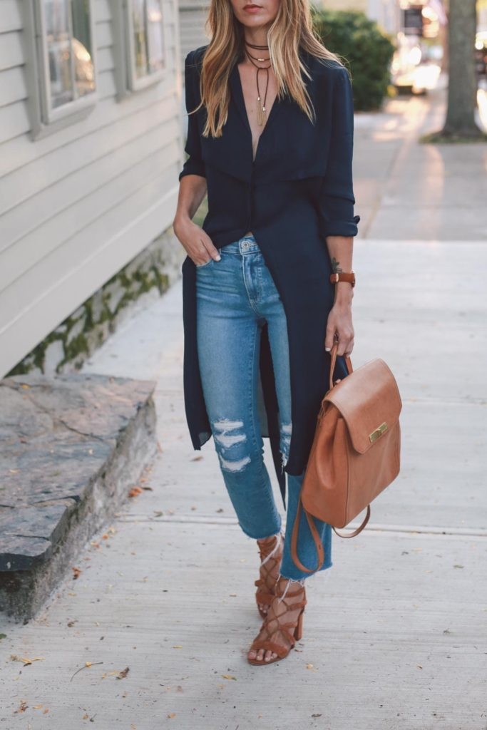 Jessica looks cute and preppy wearing patent pointed shoes and a black necktie, which plays into the current choker trend. She adds some color to the otherwise monochrome look with a large burgundy bag. Jeans: River Island