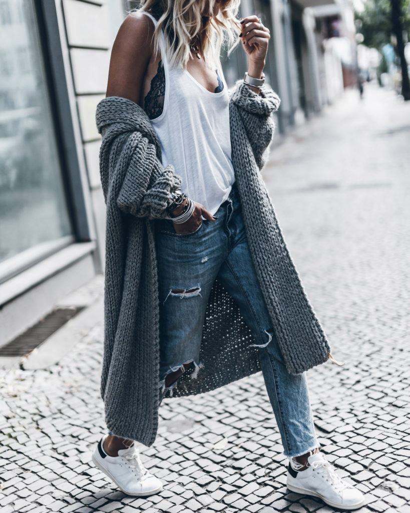 Look no further; this look is how to do comfy street wear. Jacqueline Mikuta nails it with her peek-a-boo lace bodysuit and distressed denim jeans paired with of the moment white sneakers. Bodysuit: Hunkemöller.