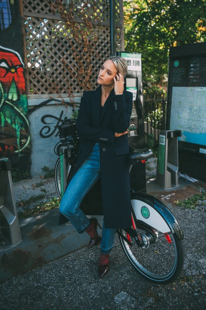 Charlotte Groeneveld has created an authentic and individual fall style here consisting of a maxi coat, cropped jeans, and a pair of simple black heels. We love this look! Coat: Zara, Knit: Tibi, Jeans/Boots: Balenciaga.
