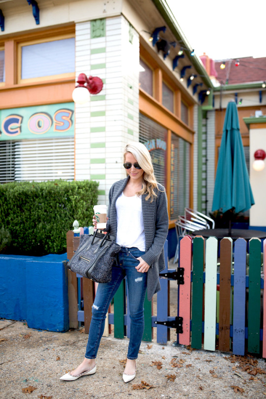 Krystal Schlegel keeps it simple in a white tee, distressed jeans, and a pair of white decorated pumps. Wear this look with a knitted cardigan and shades to steal Krystal's classic everyday style! Cardigan: Shopbop, Tee/Jeans: Nordstrom.