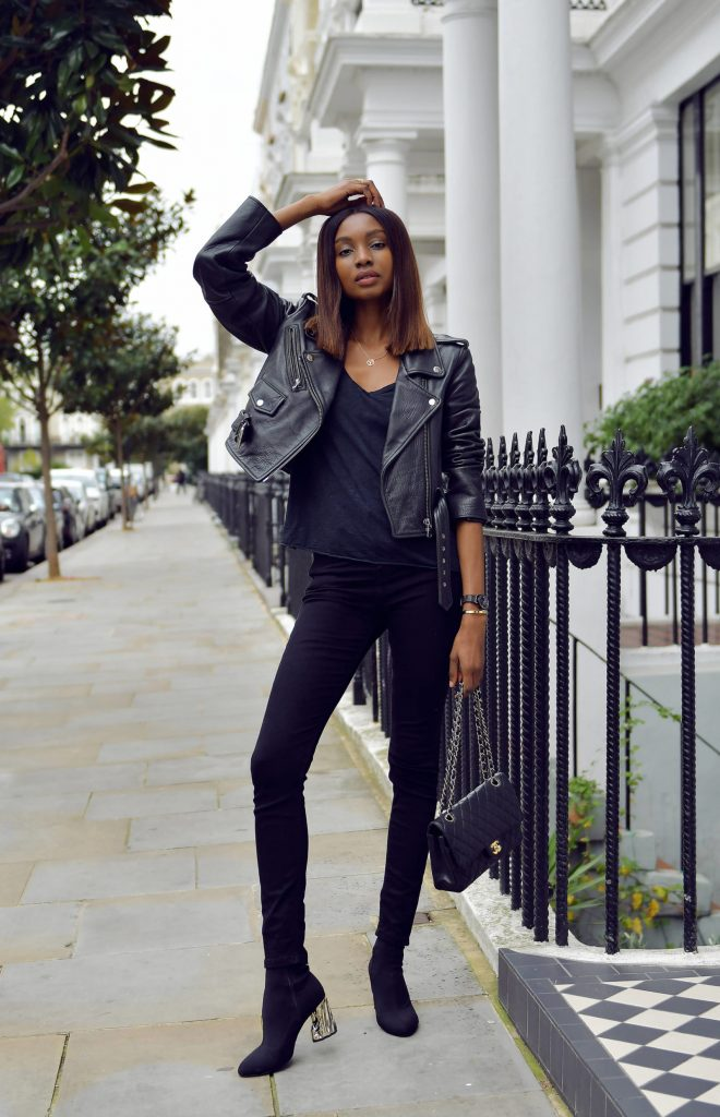 Natasha Ndlovu is rocking a sleek, androgynous style consisting of a black tee, black jeans, and a classic leather biker jacket. Wear this look with heeled boots to add that feminine edge! Jacket: Asos, Jeans: Topshop, Bag: Chanel.