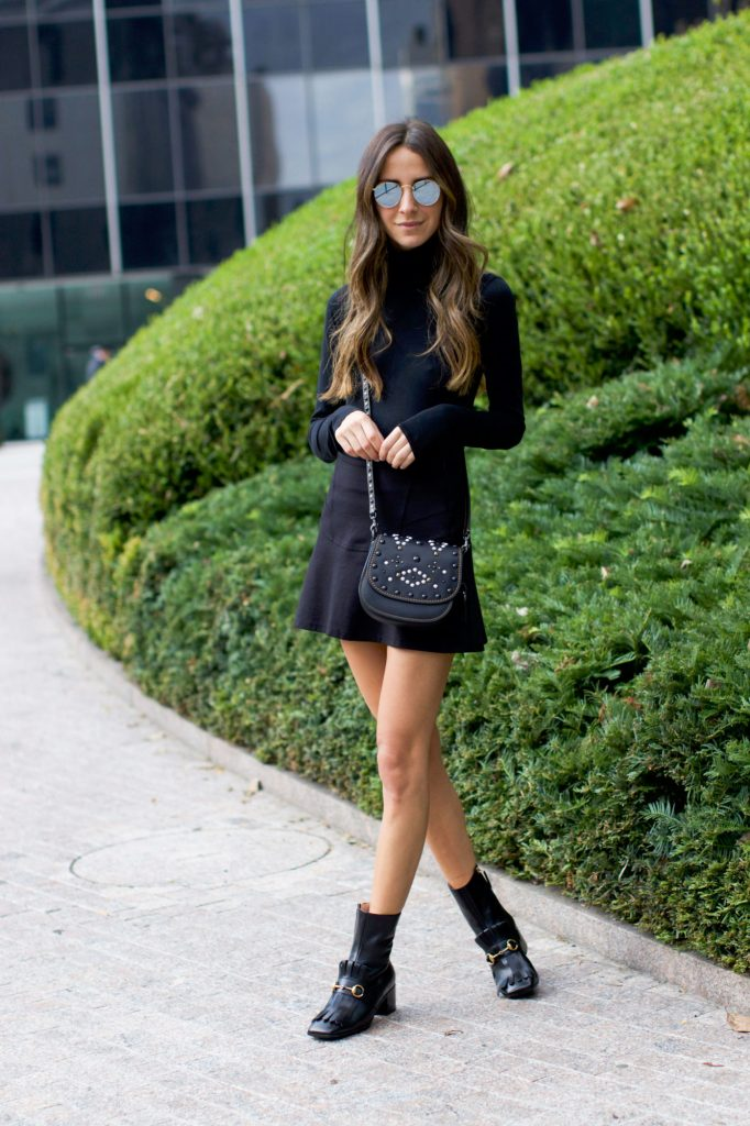 Arielle Nachami is stunning in an all black fall style, consisting of a turtleneck top, ribbed mini skirt, and leather fringed boots. This style can be adapted for cooler days by adding tights or perhaps a maxi coat! Top/Skirt: Neiman Marcus.