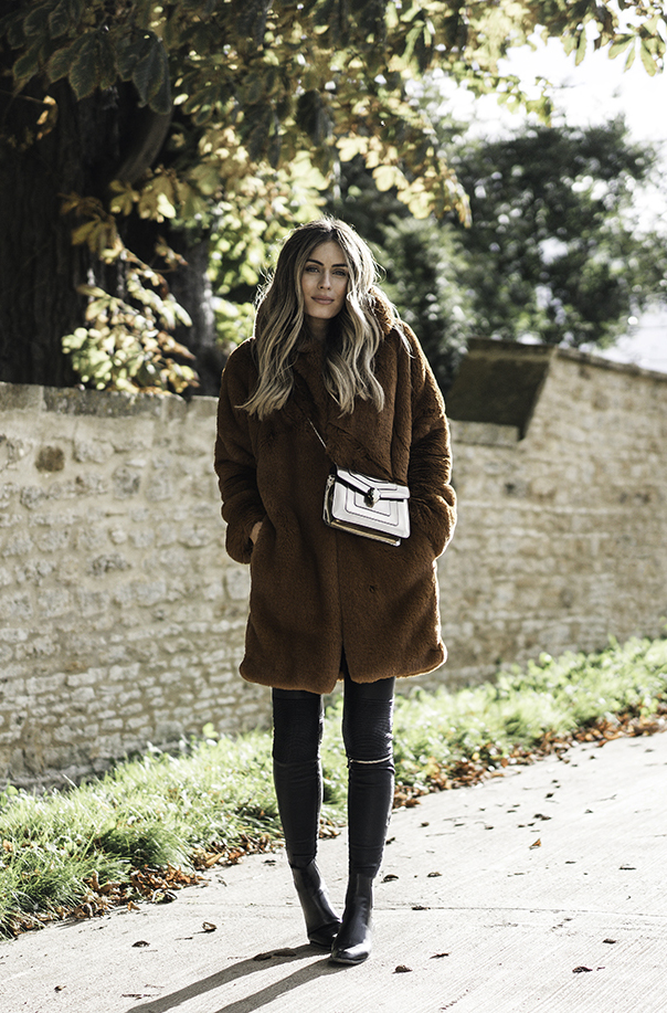 Lydia Lise Millen couldn't look cosier in this stunning faux fur coat from Karen Millen! A piece like this will always give you that authentic fall feel you've been craving. Coat: Karen Millen, Top: Me + Em, Trousers: Zara, Boots: Saint Laurent.