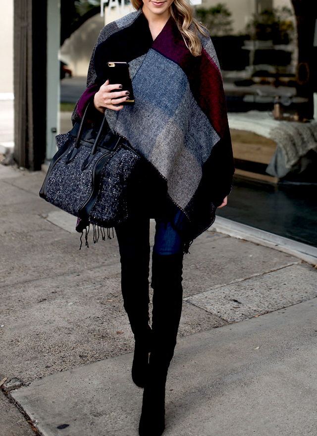 Krystal Schlegel is demonstrating exactly how to wear another of this season's hottest trends; the blanket scarf! Wear this style with jeans and thigh high boots to capture these cosy autumnal vibes. Poncho/Boots: Nordstrom, Blouse: Bordeaux.